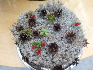 Marjatta Partasen loihtimat jäkäläkakkarat pöytien koristeena